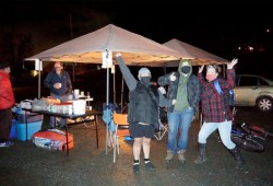 Alice Sam, Leslie Mitchell and Lisa George from the Grassroots Homelessness Coalition, and organizers of the pop-up warming centre next to the Port Alberni Friendship Centre, show their excitement on the first night of the three-day trial Dec. 11. (Karly Blats photo)