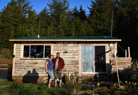 Marcie Callewaert and Lennie John pose for a photo in front of their home on Vargas Island. (Marcie Callewaert photos)