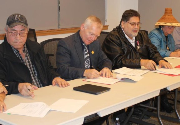 Maa-nulth Treaty First Nations representatives sign 2018 treaty update with former MLA Scott Fraser, minister of Indigenous Relations and Reconciliation at the time. (HFN photo)