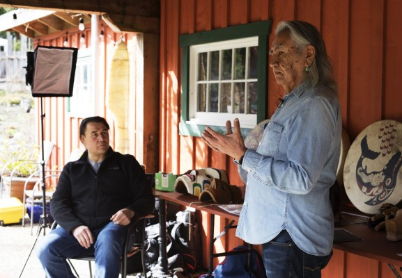 Joe David (right), a founding member of Carving on the Edge Festival, and Gordon Dick film a video segment for this year's virtual festival at the Tofino Botanical Gardens, on March 6, 2021. Photograph by Melissa Renwick